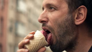 Young man eating ice cream in city, super slow motion 240fps