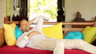 Young man sleeping on comfortable sofa at home