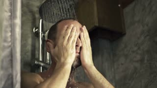 Young man wash his face under shower, super slow motion 240fps