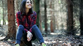 Young, pretty woman rest, enjoy forest view