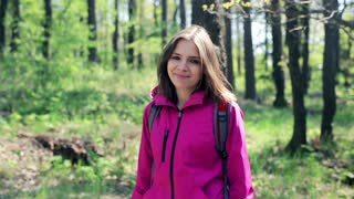 Young, pretty woman  enjoy forest view