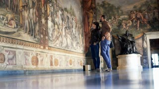 Young tourist admire fresco paintings at Capitoline Museums