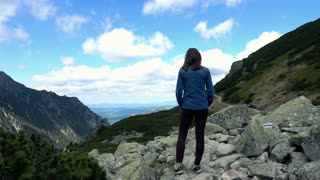Young woman admire country mountains super slow motion