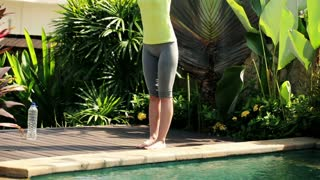 Young woman doing yoga poses in the garden