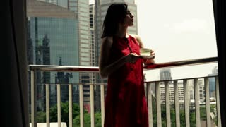 Young woman enjoying view on the terrace in the city, shot at 240fps