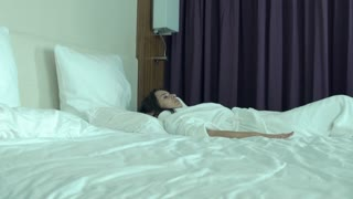 Young woman in bathrobe get up and unveil curtain in the morning, super slow motion