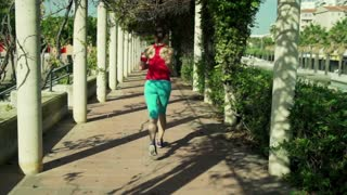 young woman jogging through park tunnel in the morning  shot at 120fps