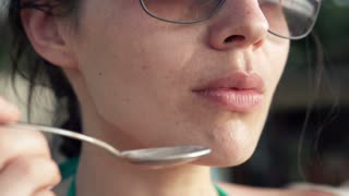 Young woman licking her lips super slow motion 240fps
