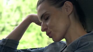 Young woman sleeping on a train, super slow motion shot at 240fps