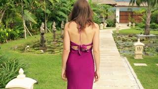 young woman walking on beautiful garden