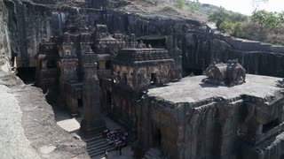 Aerial view at the entrance to Aurangabad caves, with people in front.