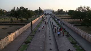 Aerial view of tourists walking through the courtyards of Taj Mahal.