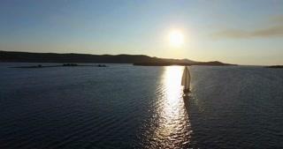 Aerial view of yacht sailing near beautiful Galesnjak Island at sunset, Croatia