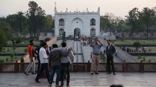 AGRA, INDIA - 12 JANUARY 2015: Tourists viewing the entrance to courtyard of Taj Mahal.