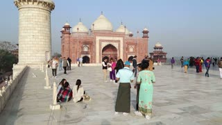 AGRA, INDIA - 26 FEBRUARY 2015: Tourists at back side patio of Taj Mahal.