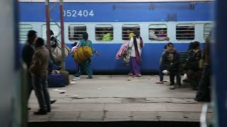 AMRITSAR, INDIA - 2 MARCH 2015: View at people on train station while departure.