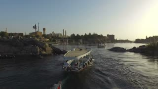ASWAN, EGYPT - FEBRUARY 5, 2016: Boats on the Nile river at sunset