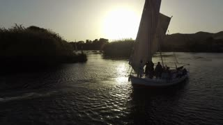 ASWAN, EGYPT - FEBRUARY 5, 2016: Tour boats on Nile river at sunset