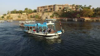 ASWAN, EGYPT - FEBRUARY 5, 2016: Tour boats on the Nile river at sunset