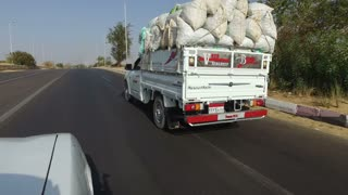 ASWAN, EGYPT - FEBRUARY 6, 2016: Pick-up truck on the road in Aswan