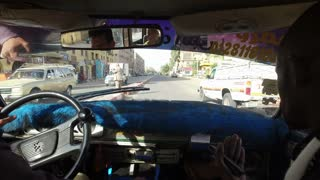 ASWAN, EGYPT - FEBRUARY 6, 2016: Woman driving in a taxi with local taxi driver and tourist guide