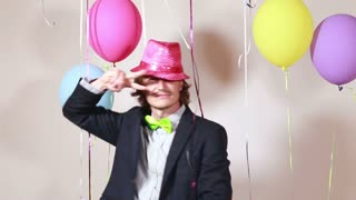 Attractive man wearing pink hat and dancing funny