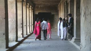 AURANGABAD, INDIA - 14 JANUARY 2015: Tourists passing through the halls of Aurangabad caves.