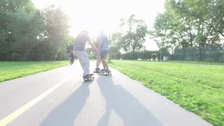 Back view of people skateboarding