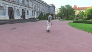Back view of young skateboarder doing tricks