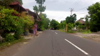 BALI - JANUARY 25: Timelapse of trip on Balinese country road on January 25, 2012 in Bali, Indonesia. With the rise in population from 800.000 to 3.5 million, road development has had to follow suit.