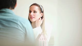Beautiful blond woman talking to man in restaurant environment