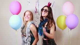 Beautiful girls dancing in photo booth