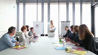 Beautiful young businesswoman on a meeting with colleagues in conference room