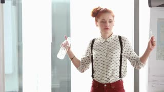 Beautiful young red hair woman giving presentation in conference room