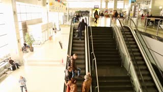 BELGRADE, SERBIA - FEBRUARY 2014: View of people on the escalator in Belgrade airport. Belgrade Nikola Tesla Airport is the primary international airport serving Belgrade, Serbia.