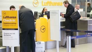 BERLIN, GERMANY - 28 JANUARY 2015: Man at check-in at Lufthansa counter at Tegel airport in Berlin, Germany.