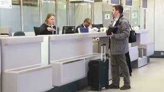 BERLIN, GERMANY - 28 JANUARY 2015: Man getting information at airport information desk at Tegel airport in Berlin.