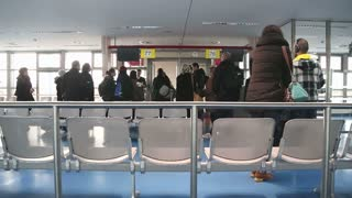 BERLIN, GERMANY - 28 JANUARY 2015: Passengers at the airport boarding lounge.