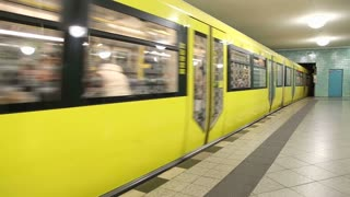 BERLIN, GERMANY - 28 JANUARY 2015: Underground railway U-bahn train coming to station and commuters walking in and out.
