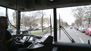 BERLIN, GERMANY - 28 JANUARY 2015: View from inside of a moving bus with driver and Berlin traffic on the way to Tegel airport.