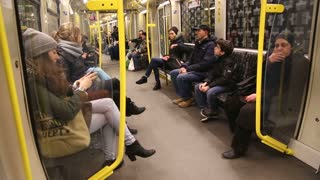 BERLIN, GERMANY - 28 JANUARY 2015: View of passengers sitting on seats in the U-Bahn wagon and it jolt and turns.