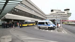 BERLIN, GERMANY - 28 JANUARY 2015: View of public bus transport, police van and group of people in front of Tegel Airport.