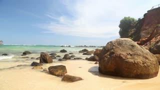 Big rocks on beautiful sandy beach in Sri Lanka