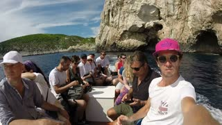 BISEVO, CROATIA - 18 AUGUST 2015: Tourists on boat in front of Blue cave. The cave is only blue for 1 hour around noon, so tourists rush to see the magical color.