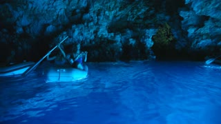 BISEVO, CROATIA - AUGUST 20: Tourists on boat in the Blue Hole cave on August 20, 2012 in Bisevo, Croatia. The cave is only blue for 1 hour around noon, so tourists rush to see the magical colour.