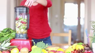 Blending fruits in electric blender, in slow motion, graded