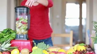 Blending fruits in electric blender, in slow motion