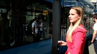 Blond beautiful girl entering the tram