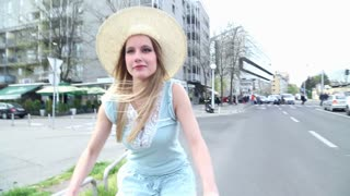 Blonde girl riding bike on the road