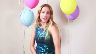 Blonde woman dancing with shiny brace string in photo booth